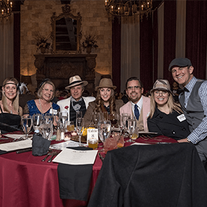 Newark Murder Mystery party guests at the table