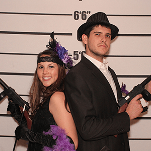 Newark Murder Mystery party guests pose for mugshots
